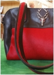 Black and red  leatherbag from Sima.