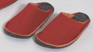 Red slippers made of felt.
