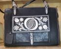 Black handbag witjh traditional embroidery from the alps
